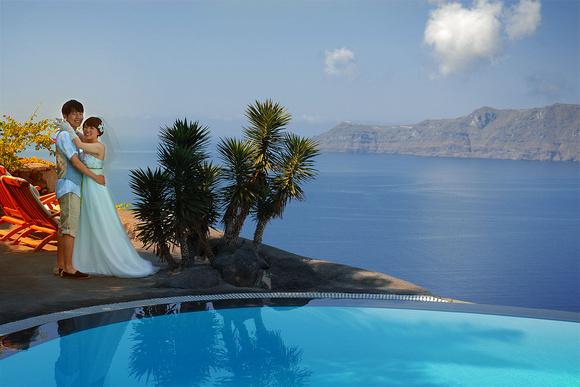 Wedding Couple near pool in Santorini