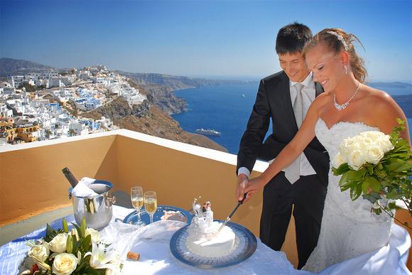 Cutting the Wedding Cake in Santorini